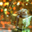 Gift box and twinkle lights. — Stock Photo