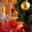 Stock Photo: Champagne in glasses and christmas tree.