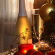 Champagne in glasses and christmas tree. - Stock Photo