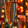 Royalty-Free Stock Photo: Champagne and lights on bakground.