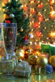 Champagne in glasses and christmas tree. — Foto de Stock