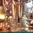 Champagne in glasses,candle lights and gifts. — Stock Photo #7877334