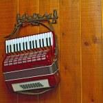Decorative accordion on a wall — Stock Photo
