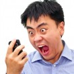Постер, плакат: Crazy angry aian man yelling at phone