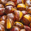 Stockfoto: Popular Chinese snack stir fried chestnuts with sugar