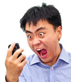 Crazy angry aian man yelling at phone — Stock Photo