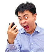 Crazy angry asian man yelling at phone — Stock Photo