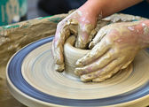 Hands working on pottery — Stock Photo