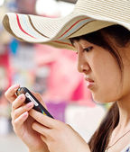 A girl reading sms from a mobile — Stock Photo