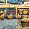 Landscape photo of cargo carriages and trains in industrial fact - Stock Photo