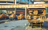 Landscape photo of cargo carriages and trains in industrial fact — Stock Photo