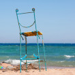 Old seat on the beach — Stock Photo