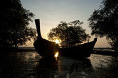 Long boats in sunset — Stock Photo
