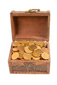 An old trunk with shiny coins isolated — Stock Photo