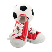 Red baby sneakers with a ball isolated on white — Stock Photo