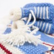 Stock Photo: Handmade sweet baby booties isolated
