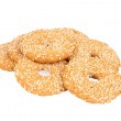 Round cookies with sesame seeds isolated on white — Stock Photo
