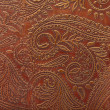 Foto Stock: Floral pattern in brown leather