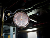 Old style hanging clock with iron work — Stock Photo