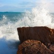 The waves breaking on a stony beach, forming a big spray — Stock Photo #7189718