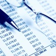 Stock Photo: Closeup of chart with pen & glasses