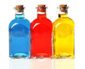 Blue, red, and yellow bottles — Stock Photo