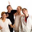 Small group of young men. Studio shot over white. — Stock Photo