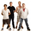 Stock Photo: Small group of young men. Studio shot over white.