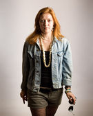 Casual young woman. Studio shot over grey. — Stockfoto