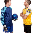 Stock Photo: Male soccer players. Studio shot over white.