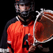 Male lacrosse player. Studio shot over black. — Stock Photo #7871719