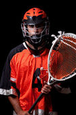 Male lacrosse player. Studio shot over black. — Stock Photo