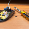 Royalty-Free Stock Photo: Repair of the computer mouse.