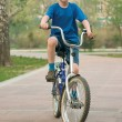 Boy goes for a drive on a bicycle. — Stock Photo