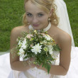 Stock Photo: Beautiful bride with bouquet of flowers.