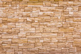 The wall constructed of stones. — Stock Photo