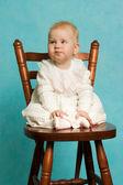 Baby make a wry face. — Stock Photo