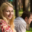 Man and woman in the park. — Stock Photo