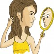 Royalty-Free Stock  : Girl looking at the mirror on white