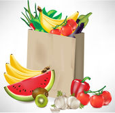 Grocery bag with lots of fruits and vegetables — Stock Vector