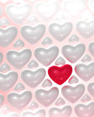 Red glossy heart surrounded by bright hearts — Stock Photo