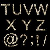 Alphabet: set of broken into pieces golden letters isolated on black — Zdjęcie stockowe
