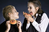 Boys eating Halloween cookies — Stock Photo