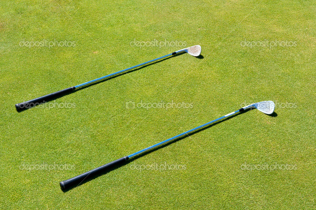 Two golf club lying on the grass — Stock Photo #6769348
