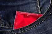 Condom in pocket — Stock Photo