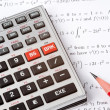 Scientific Calculator Next to Maths — Stock Photo #6989381