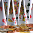 Stock Photo: Castle of Cards and Coins