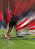 Football player line blur zoom effect — Stock Photo