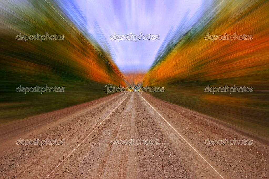 Autumn colors along rural dirt road, zooming effect (dirt road sharp) — Stockfoto #6923733