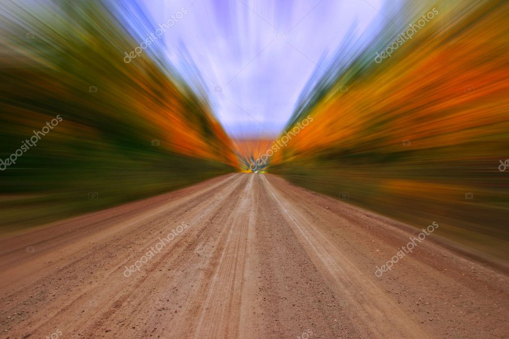 Autumn colors along rural dirt road, zooming effect (dirt road sharp) — Zdjęcie stockowe #6923733